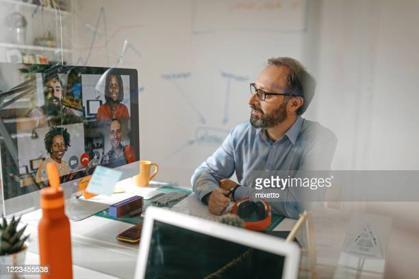 video call with team members - one man only stock pictures, royalty-free photos & images