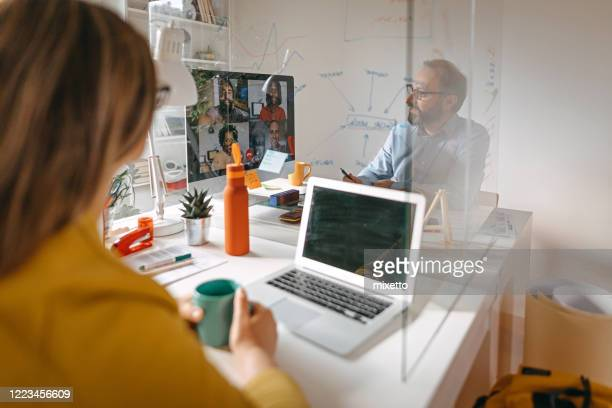 video call with team members - social issues stock pictures, royalty-free photos & images