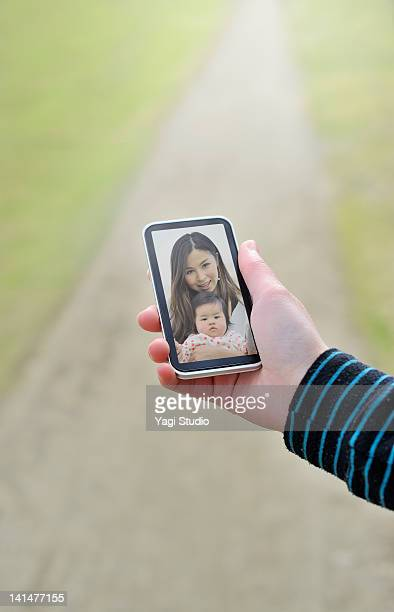 Video calling on a  smart phone.