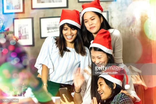 Video calling overseas friend during Christmas celebration in Malaysia