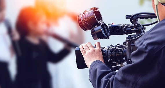 Video camera operator working with his equipment 801862134