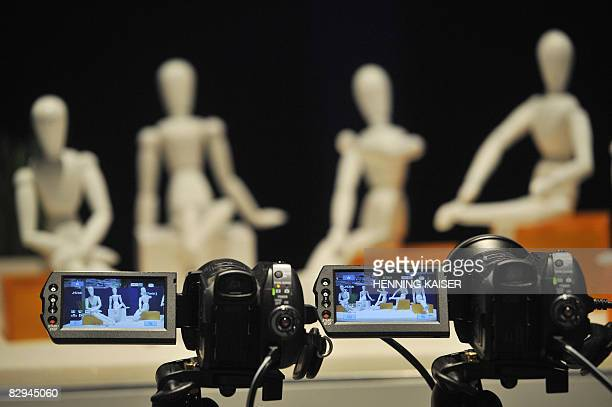 Video cameras are on display during a press preview of the Photokina trade fair for the photographic and imaging sector on September 22, 2008 in...