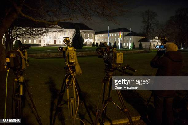 Video cameras of media crews are seen aimed towards Schloss Bellevue presidential palace as German Chancellor and leader of the German Christian...