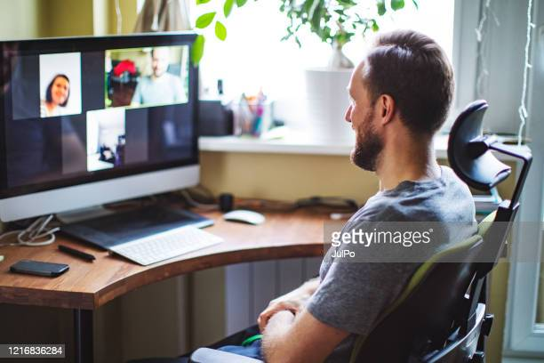 video chatting with friends during social distancing - medium group of people stock pictures, royalty-free photos & images