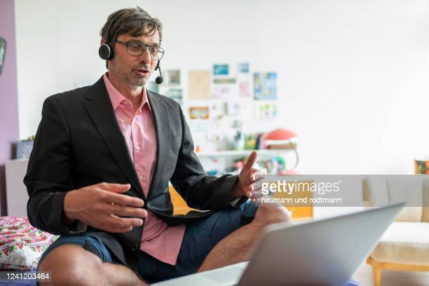 video conference im homeoffice in shorts-berlin may 2020 - shorts stock pictures, royalty-free photos & images