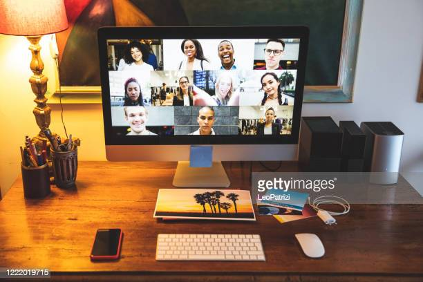 video conference on desktop computer screen in home studio - illness prevention stock pictures, royalty-free photos & images