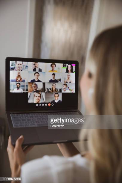 video conference with business colleagues, young woman working from home - vertical stock pictures, royalty-free photos & images