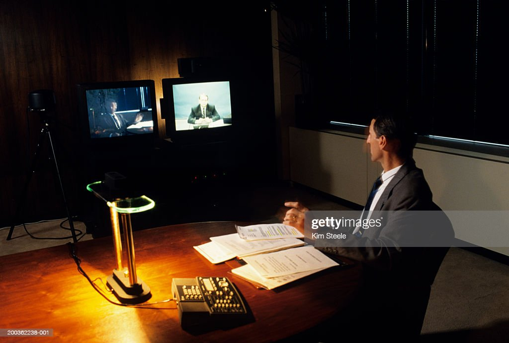 Video conference with cameras and monitors : Stock Photo