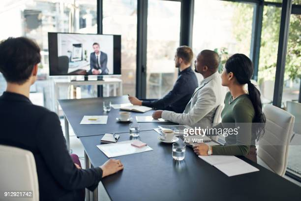 video conferencing technology lets us hold face-to-face meetings - webinar stock photos and pictures