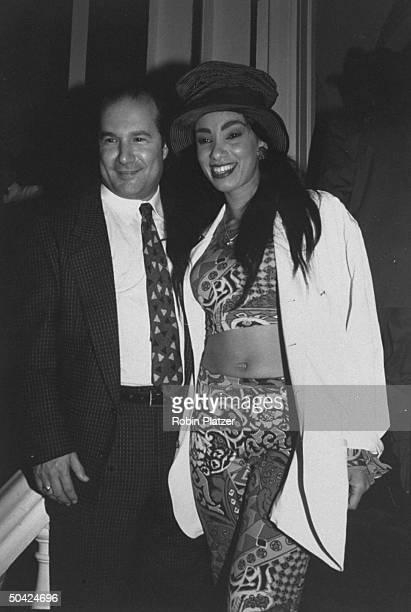 Video disc jockey Downtown Julie Brown w. An unident. Man at a party to celebrate the Grammy Awards.