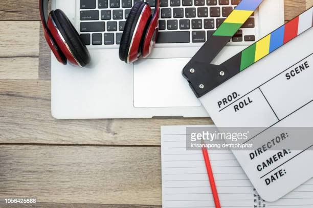 video editing,office stuff with movie clapper laptop - producer stock pictures, royalty-free photos & images