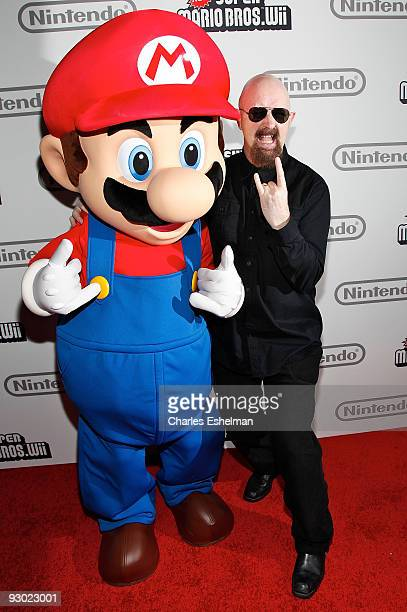 Video game character Mario and Judas Priest singer/songwriter Rob Halford attend the 25 years of Mario celebration at the Nintendo World Store on...