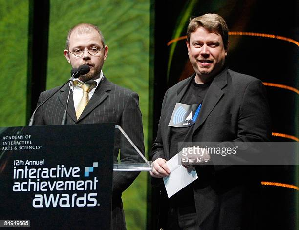 Video game designer Toby Gard and chief creative officer and cofounder of Big Red Button Entertainment Dan Arey present an award at the Academy of...
