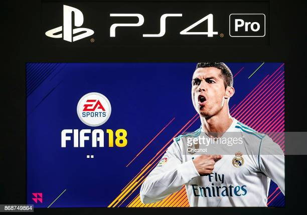 Video game 'FIFA 18' developed by EA Canada and published by EA Sports is seen on the sceen of a Sony PlayStation game console PS4 Pro during the...