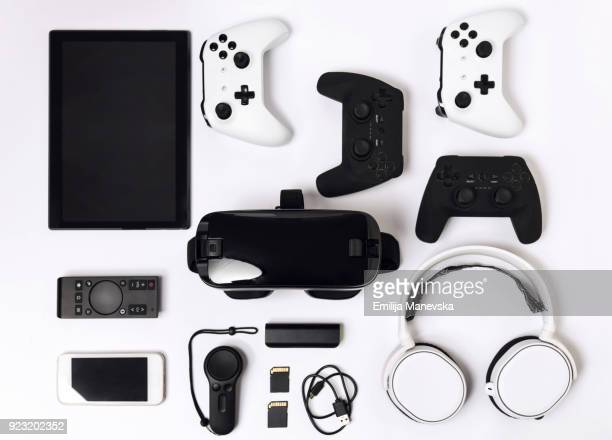 video game gadgets on white background - mobiles gerät stock-fotos und bilder