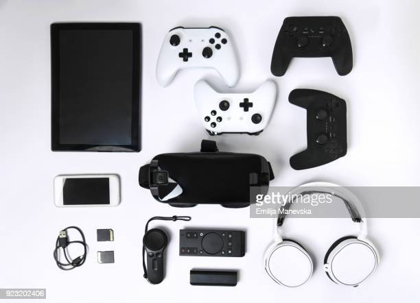 video game gadgets on white background - finance and economy stock pictures, royalty-free photos & images