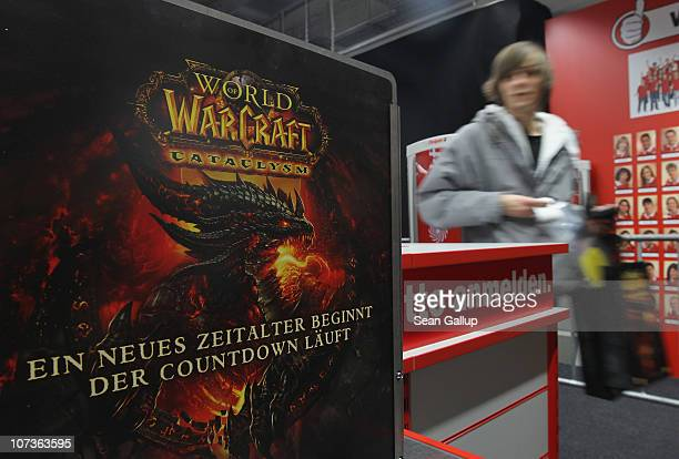 A video gaming enthusiast departs after buying the new 'World of Warcraft Cataclysm' game shortly after midnight at the game's global sales premiere...