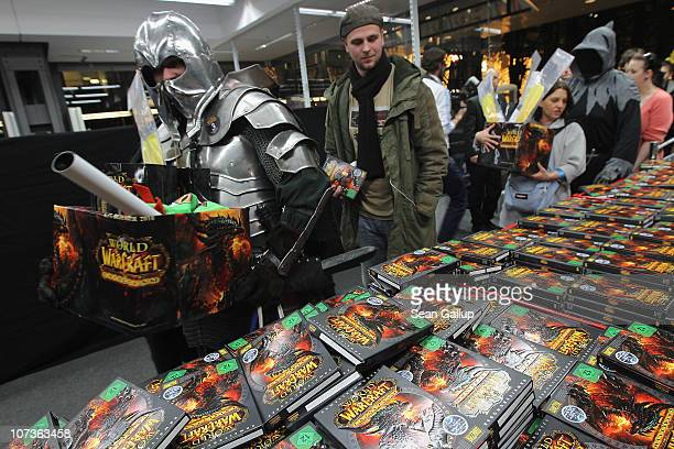 Video gaming enthusiasts including one who had one a World of Warcraft costume contest shortly before scoop up the new 'World of Warcraft Cataclysm'...