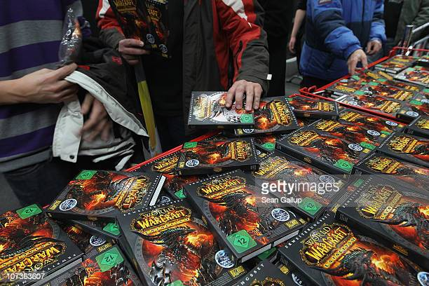 Video gaming enthusiasts scoop up the new 'World of Warcraft Cataclysm' game shortly after midnight at the game's global sales premiere at MediaMarkt...