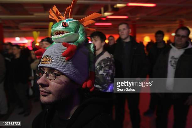 Video gaming enthusiasts watch a 'World of Warcraft' show while waiting to purchase the new 'World of Warcraft Cataclysm' game shortly before...