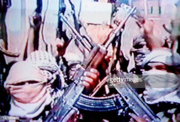 A video grab dated 19 June 2001 shows members of Saudi dissident Osama bin Laden's AlQaeda or 'The Base'organization carrying AK47 submachineguns in...