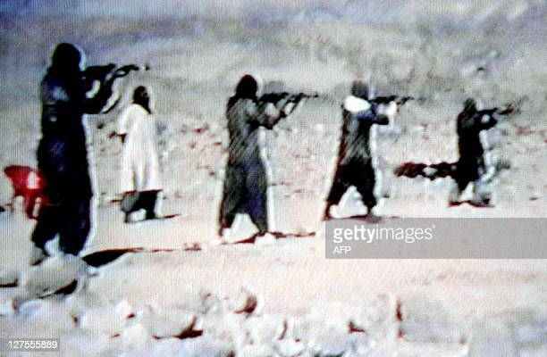 A video grab dated 19 June 2001 shows members of Saudi dissident Osama bin Laden's AlQaeda or 'The Base' organization training with AK47...