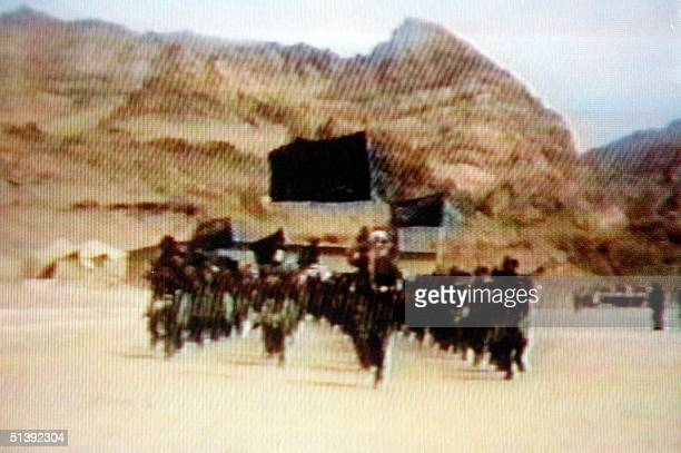 A video grab dated 19 June 2001 shows members of Saudi dissident Osama bin Laden's alQaeda or 'The Base' organization training in a video tape said...