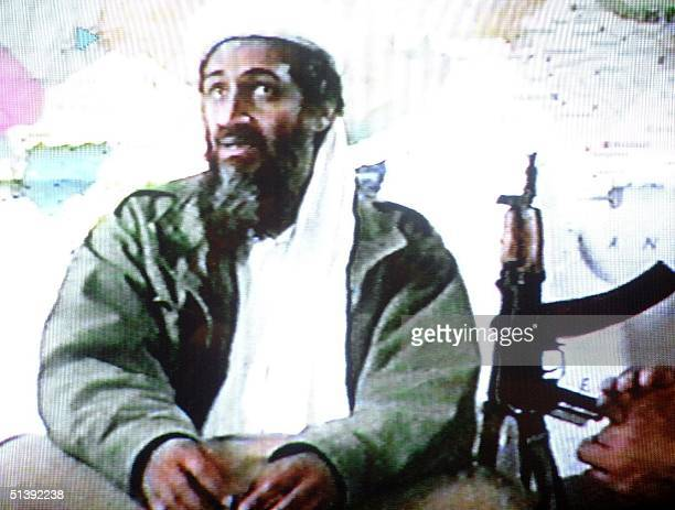 A video grab dated 19 June 2001 shows Saudi dissident Osama bin Laden in a video tape said to have been prepared and released by bin Laden himself...
