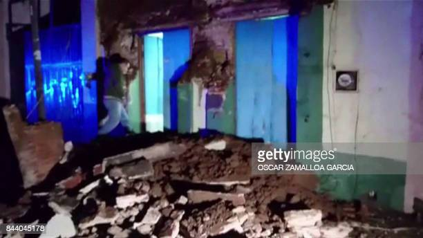 A video grab made from AFPTV footage shows damage to a building in downtown Oaxaca on September 8 2017 after a powerful 82magnitude earthquake rocked...