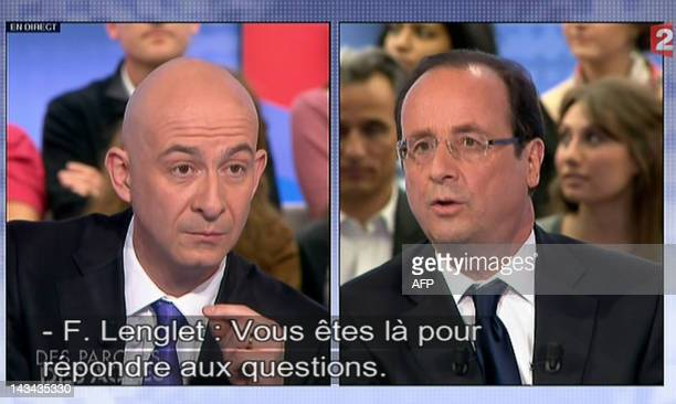 A video grab made on April 26 2012 shows French socialist party candidate for French 2012 presidential election Francois Hollande answering to...