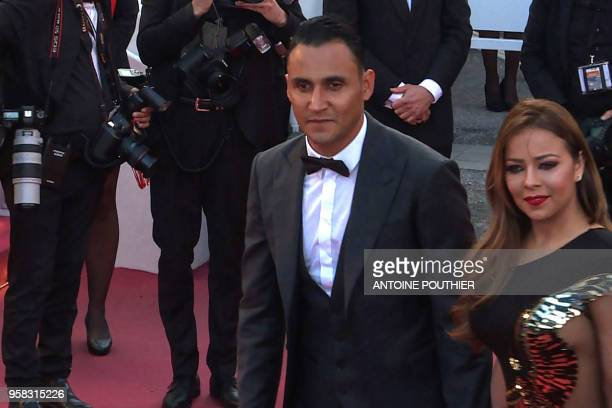 A video grab made on May 13 2018 shows Real Madrid's Costa Rican goalkeeper Keylor Navas and his wife Andrea Salas arriving on the red carpet after...