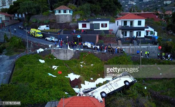 A video grab obtained from drone footage shows the wreckage of a tourist bus that crashed on April 17 2019 in Canico on the Portuguese island of...