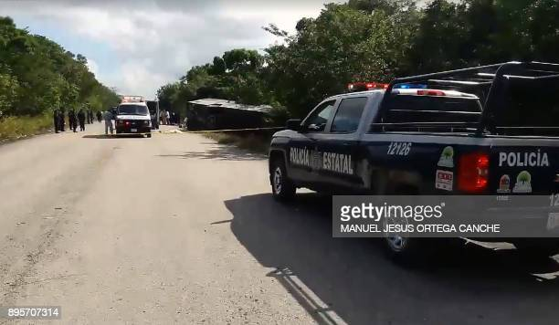 Video grab of a police van and and an ambulance seen in the area where a bus driving tourists to Chacchoben archaeological zone overturned in the...