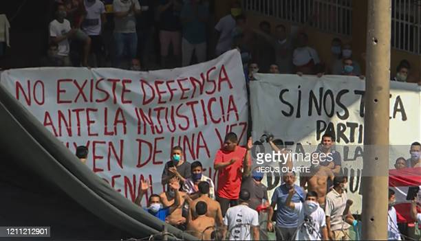 Video grab of inmates chanting in protest after a prison riot took place over fears of the new coronavirus at the Castro Castro prison in Lima on...