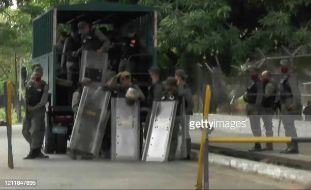 Video grab of members of Bolivarian National Guard as they are deployed outside Los Llanos prison, in Guanare, Portuguesa state, Venezuela on May 2...