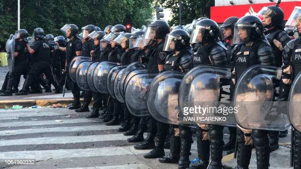 Video grab showing a cordon of riot police during clashes with supporters of River Plate in the surroundings of the Monumental stadium in Buenos...