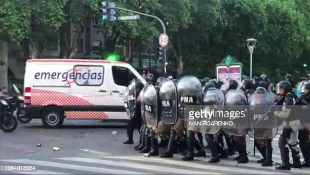 Video grab showing an ambulance making its way through a cordon of riot police during clashes with supporters of River Plate in the surroundings of...