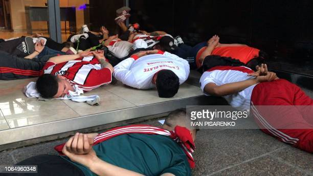 Video grab showing detained supporters of River Plate during clashes in the surroundings of the Monumental stadium in Buenos Aires following an...