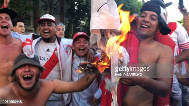 Video grab showing supporters of River Plate burning a tshirt with the badge of Boca Juniors in the surroundings of the Monumental stadium in Buenos...
