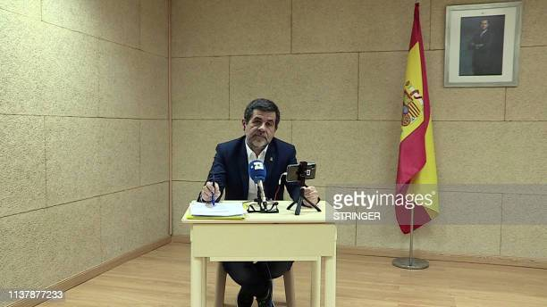 A video grab shows Jordi Sanchez the leading candidate for Catalan separatist party Junts per Catalunya Together for Catalonia holding a press...