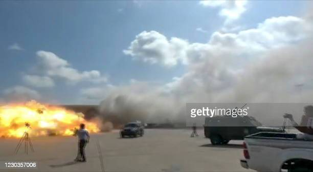 Video grab shows the moment an ordnance hit the airport in the southern Yemeni port city of Aden on December 30 shortly after the arrival of a plane...