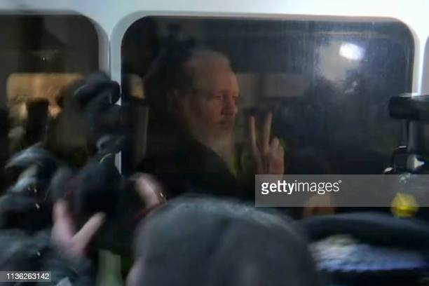 TOPSHOT A video grab taken from AFP TV footage shows WikiLeaks founder Julian Assange as he is driven by British Police to Westminster Magistrates...