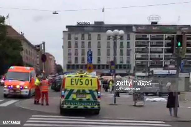 A video grab taken from the Twitter account of Juha Riihimaki on August 18 2017 shows officials standing in a street in the Finnish city of Turku...