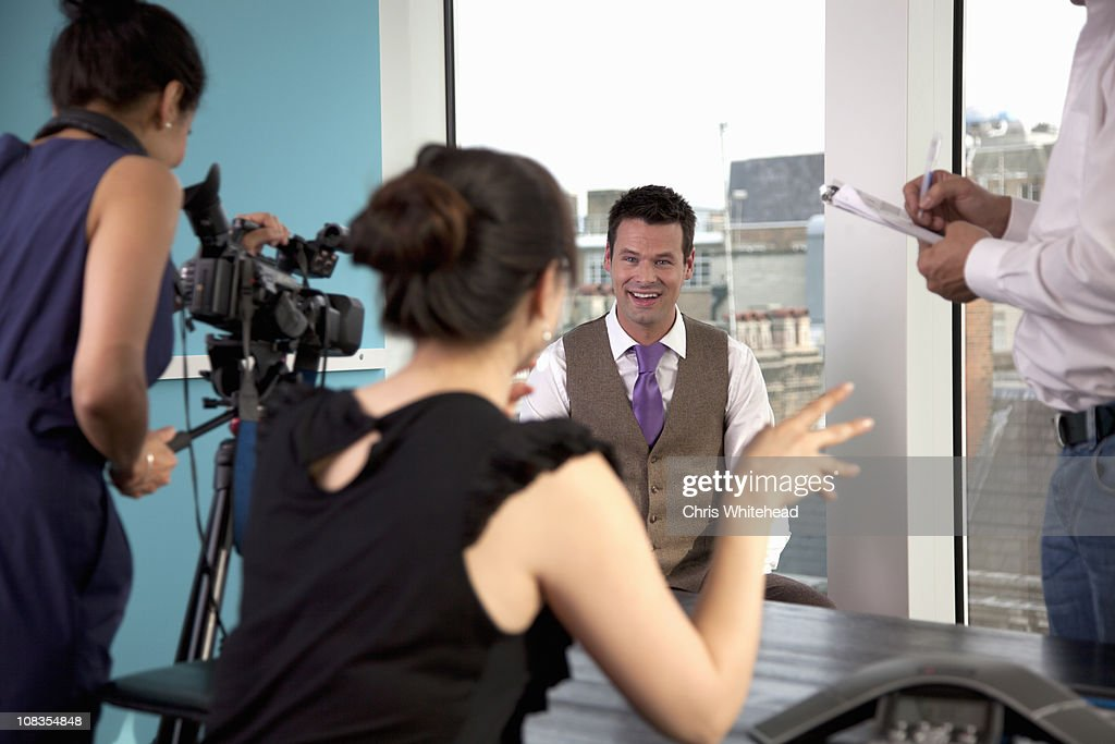 Video interview of businessman : Stock Photo