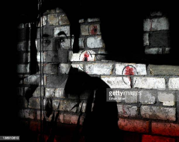 A video is projected on a piece of the brick wall from the February 14 St Valentine's Day Massacre as part of a display at The Mob Museum February 13...