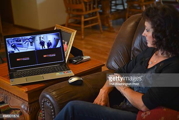 A video is seen on a laptop of the jail where Tony 'Chance' Ross was held and tased while in custody as his mother Shelley Ross watches during an...