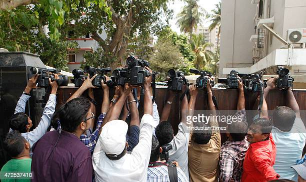 Video journalists trying to get glimpse of Bollywood actor Salman Khan over the outer boundary wall of Salman Khans residence as he leaves for court...