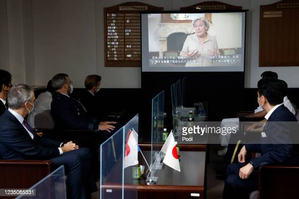 Video message by Ank Bijleveld, Netherlands' Defence Minister, on screen, while Nobuo Kishi, Japan's Defence Minister, right, meets with Peter van...