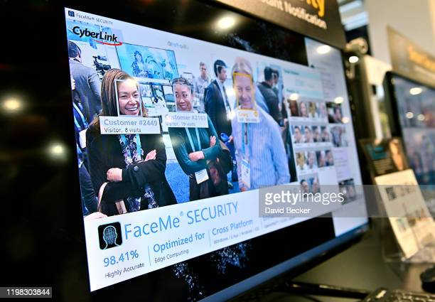 A video monitor displays attendees as their images are captured with CyperLink's facial recognition during CES 2020 at the Las Vegas Convention...