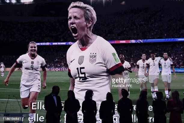 Video of Reign FC's US midfielder Megan Rapinoe is displayed after she won the Ballon d'Or France Football 2019 women's trophy at the Chatelet...